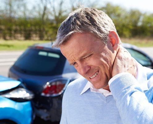 Man grasping neck and wincing after an auto accident