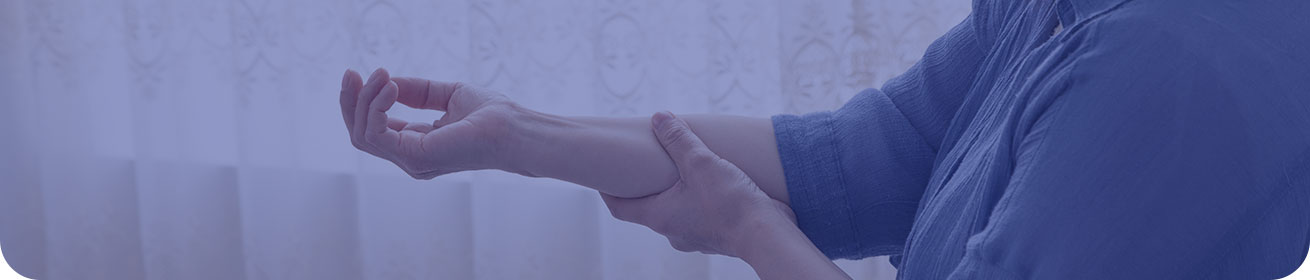 Banner image: a close-up of a woman grabbing her forearm, as if in pain