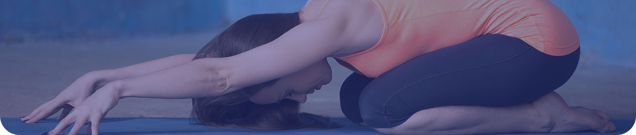 Banner image: a woman crouched down into a yoga pose