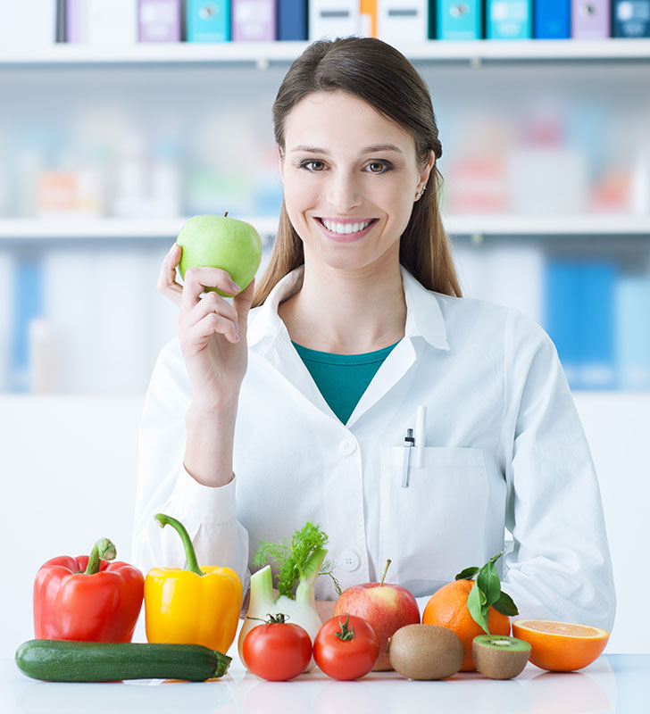 Nutritionist with Fruits and Vegetables