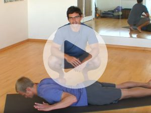 Video still of a back extension stretch