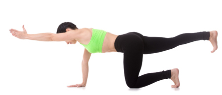 Woman in yoga gear, balancing on her right hand and right knee, torso flat, with left arm and leg outstretched
