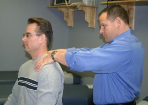Dr. Nault Working on Patient with Shoulder Pain