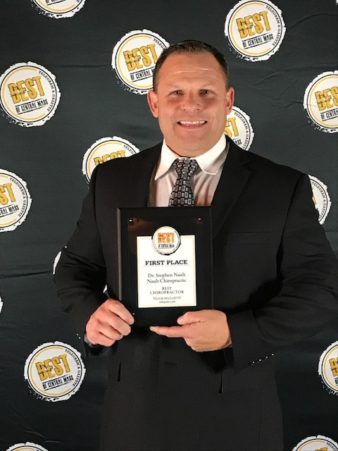 Doctor Nault holding his Best in Central Mass award for best chiropractor